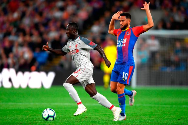 Naby Keita of Liverpool goes past Andros Townsend of Crystal Palace. Photo: Getty Images
