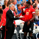 Jose Mourinho attempts to get his message across to Paul Pogba. Photo: Getty Images