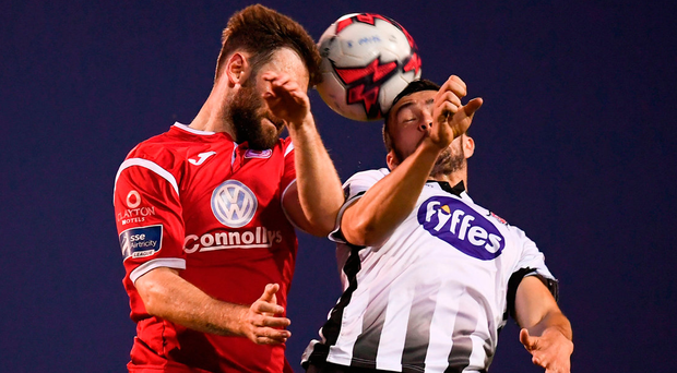 Dundalk's Michael Duffy (right) battles for the ball with Kyle Callan-McFadden. Photo: Sportsfile