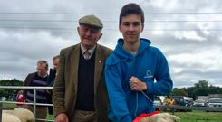 Paddy Beirne, Knockmaine, Athleague, Co Roscommon and his grandson Kevin pictured with their Champion Galway ram at Roscommon Agricultural Show last weekend