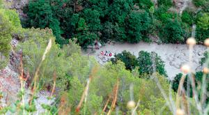 Emergency services work to bring stranded hikers to safety in the Raganello Gorge in Civita, Italy, yesterday. Photo: AP