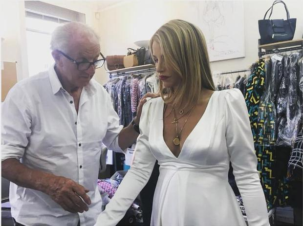 Paul Costelloe and Vogue Williams during a dress fitting | Photo via Instagram.com / PaulCostelloeOfficial
