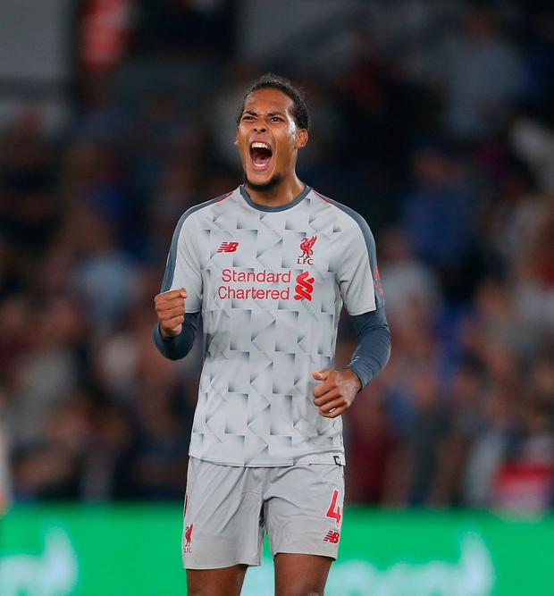 Van Dijk celebrates at the end of the game. Photo by Rob Newell - CameraSport via Getty Images