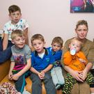 Margaret Cash with six of her seven children after the homeless family had to sleep at Tallaght garda station