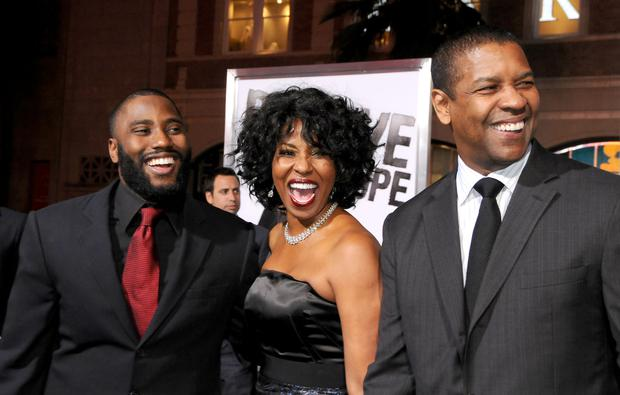 HOLLYWOOD, CA - JANUARY 11: John David Washington, Pauletta Washington and Denzel Washington arrive at
