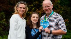 Katie Kennedy (15) with consultant neurosurgeon John Caird and her mother Paula. Photo: Mark Condren