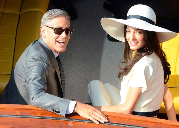 Hollywood's highest earner for 2018, actor and director George Clooney with his wife Amal