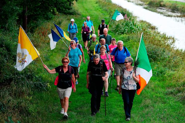 Walkers at the Grand Canal Way, Ballycommon, Co Offaly. Photo: PA
