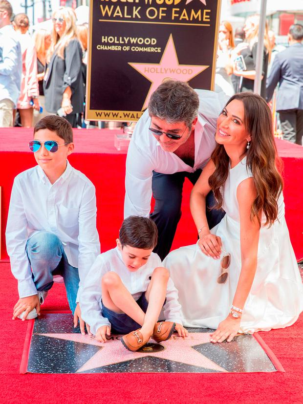 Simon Cowell, Lauren Silverman, Eric Cowell and Adam Silverman attend a ceremony honoring Cowell with a star on the Hollywood Walk of Fame on August 22, 2018 in Hollywood, California. (Photo by Rich Fury/Getty Images)