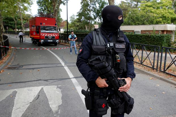 French police secure a street after a man killed two persons and injured an other in a knife attack in Trappes, near Paris, according to French authorities, France, August 23, 2018. REUTERS/Philippe Wojazer