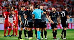 Burnley's Chris Wood and Jeff Hendrick remonstrate with referee Slavko Vincic after he awarded a penalty to Olympiacos