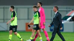 Celtic manager Brendan Rodgers with his players after the match. Photo: REUTERS/Ints Kalnins
