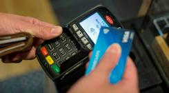 Some five million debit cards are now in the hands of consumers, according to the Central Bank. Photo: Bloomberg