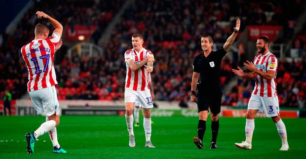 Ryan Shawcross and James McClean appeal to the referee during Stoke's defeat against Wigan. Photo: Nick Potts/PA Wire