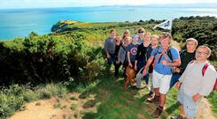 Hill walking guide Shane O'Doherty, centre, with a group of tourists on Howth Head. Photo: Gerry Mooney