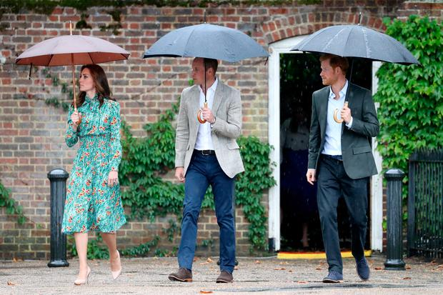 (L-R) Catherine, Duchess of Cambridge, Prince William, Duke of Cambridge and Prince Harry are seen during a visit to The Sunken Garden at Kensington Palace on August 30, 2017 in London, England
