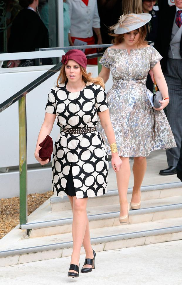 Princess Beatrice and Princess Eugenie attend Derby Day at The Derby Festival on June 1, 2013 in Epsom, United Kingdom. (Photo by Danny E. Martindale/Getty Images)