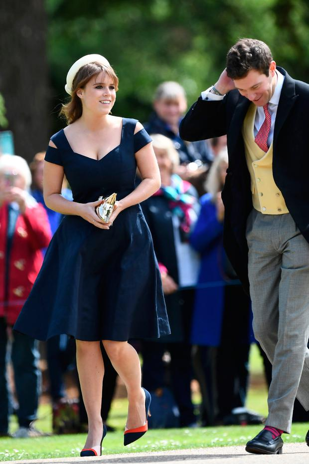 Britain's Princess Eugenie of York (L) attends the wedding of Pippa Middleton and James Matthews at St Mark's Church in Englefield, west of London, on May 20, 2017