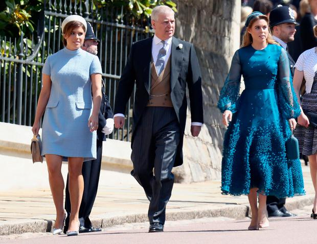 Britain's Prince Andrew, Duke of York, and his daughters Britain's Princess Eugenie of York (L) and Britain's Princess Beatrice of York arrive for the wedding ceremony of Britain's Prince Harry, Duke of Sussex and US actress Meghan Markle at St George's Chapel, Windsor Castle, in Windsor, on May 19, 2018. (Photo by Chris Jackson / POOL / AFP)