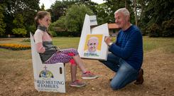 John McGarry and his daughter Lucy (10) with a portable chair.