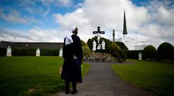 A nun stands in front of a scene of the crucifix of Jesus in the Marian Shrine in Knock earlier this week. Picture: Reuters