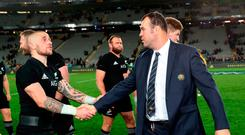 New Zealand's TJ Perenara and Australia's coach Michael Cheika (R) shake hands after New Zealand's victory in the second rugby Test match between New Zealand and Australia at Eden Park in Auckland on August 25, 2018. (Photo by MICHAEL BRADLEY / AFP)MICHAEL BRADLEY/AFP/Getty Images