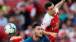 West Ham's Lucas Perez in action with Arsenal's Granit Xhaka