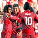 Liverpool's Mohamed Salah celebrates with Roberto Firmino after scoring their first goal