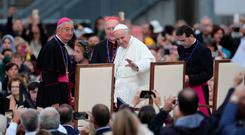 Pope Francis arrives at Croke Park Stadium in Dublin, to join an audience of 82,500 and hear five testimonies by families from Ireland, Canada, Iraq, and Africa, during the Festival of Families event, as part of his visit to Ireland. Photo: Aaron Chown/PA Wire