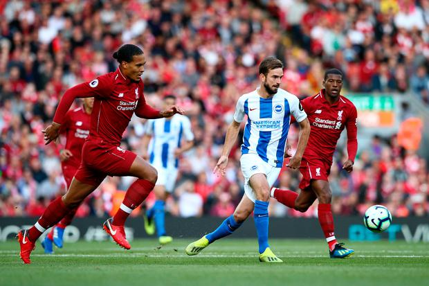 Davy Proepper of Brighton and Hove Albion in action as Virgil van Dijk and Georginio Wijnaldum of Liverpool look on. Photo: Getty Images