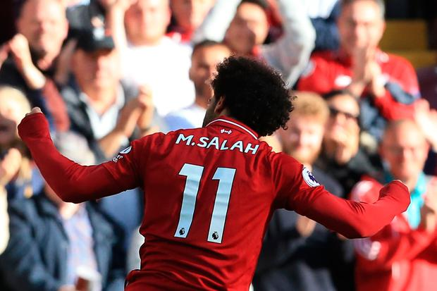 Liverpool's Egyptian midfielder Mohamed Salah celebrates scoring the opening goal. Photo: Getty Images