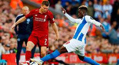 James Milner is tackled by Brighton's Yves Bissouma during yesterday's Premier League clash at Anfield. Photo: Reuters