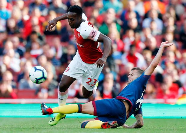 Arsenal's English striker Danny Welbeck (L) is challenged by Jack Wilshere (R). Photo: Getty Images