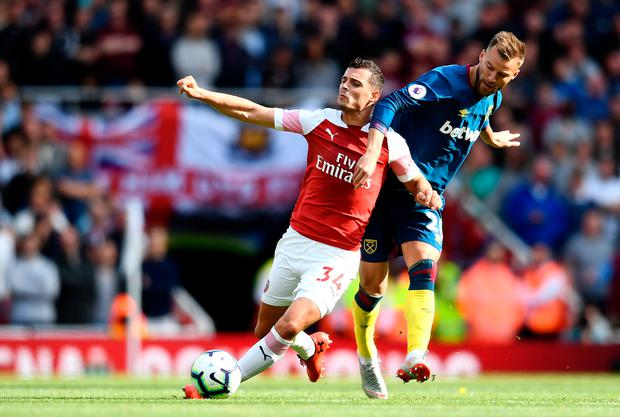 Granit Xhaka of Arsenal is challenged by Andriy Yarmolenko of West Ham United. Photo: Getty Images