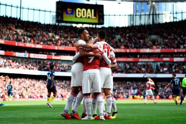 Arsenal players celebrate their team's second goal, an own goal scored by Issa Diop of West Ham United (not pictured). Photo: Getty Images