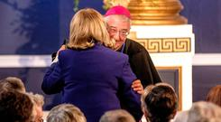 A WARM HUG: Bishop Diarmuid Martin greets former president Mary McAleese at St Patrick's Hall in Dublin Castle. Photo: Doug O'Connor