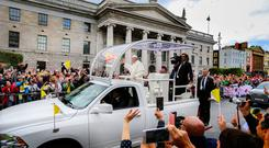 CEAD MILE FAILTE: Above, Pope Francis in Dublin city centre yesterday as thousands thronged the streets of the capitol to welcome the Pontiff. Photo: David Conachy