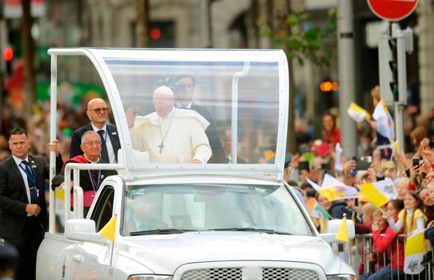 CAVALCADE: Pope Francis braved the weather to greet the people of Ireland in an open-topped Pope-mobile in Dublin. Photo: Caroline Quinn
