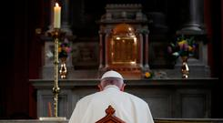 Pope Francis prays inside St Mary's Pro Cathedral during his visit to Dublin. REUTERS