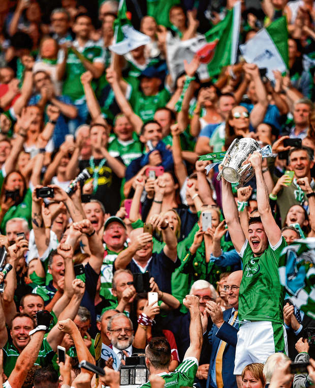 Limerick's Declan Hannon lifts the Liam MacCarthy Cup to the delight of the county's supporters. Photo: Sportsfile