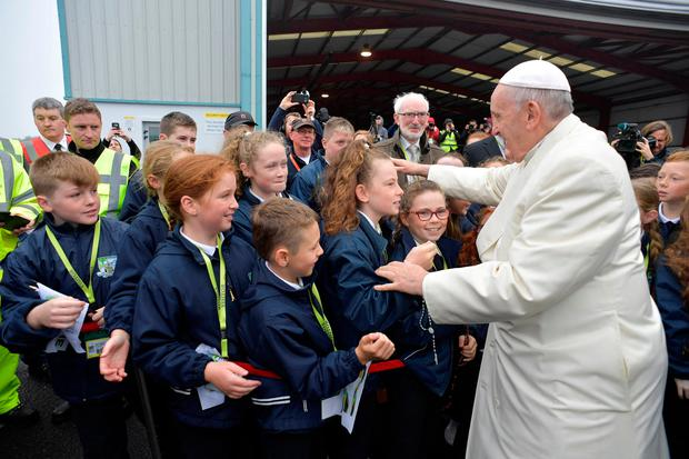 Pope Francis greets children after arriving in Knock, Ireland August 26, 2018. Vatican Media/Handout