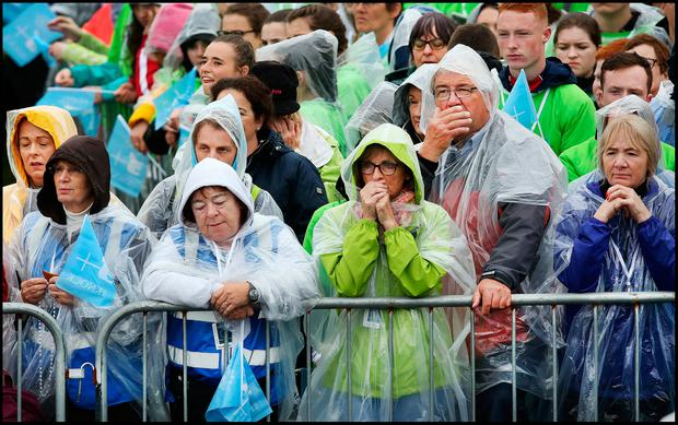 Pilgrims listen to Pope Francis address the crowd at Knock Shrine. Pic Steve Humphreys 26th August 2018