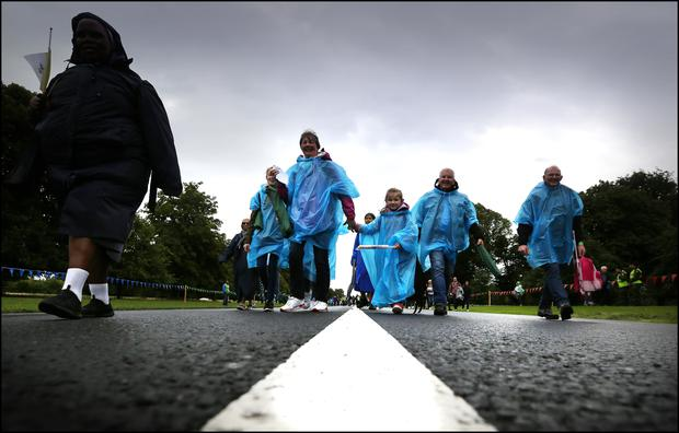 Pilgrims arriving in the Phoenix Park for Pope Francis closing Mass. Picture By David Conachy.