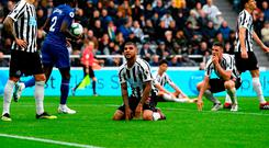 Deandre Yedlin of Newcastle United and his teammates look dejected as Deandre Yedlin scores an own goal, Chelsea's second goal during the Premier League match between Newcastle United and Chelsea FC at St. James Park on August 26, 2018 in Newcastle upon Tyne, United Kingdom.