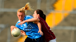 Dublin forward Carla Rowe is tackled by Galway's Emer Flaherty during the TG4 All-Ireland Ladies Football semi-final at Dr Hyde Park on Saturday. Photo: Sportsfile