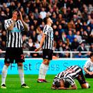 Newcastle players are down and out after DeAndre Yedlin's own goal at St James' Park. Photo by Stu Forster/Getty Images