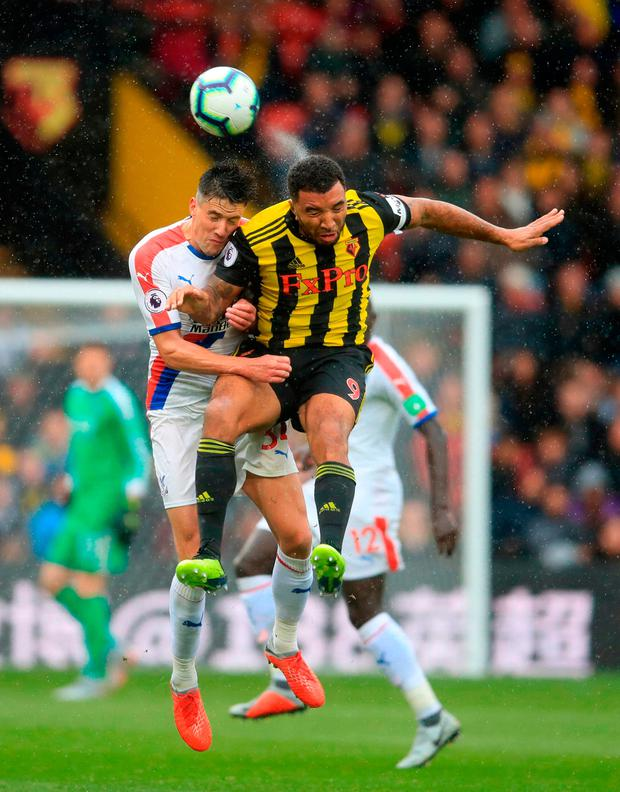 Watford's Troy Deeney (right) and Crystal Palace's Martin Kelly battle for the ball. Photo credit: Adam Davy/PA Wire