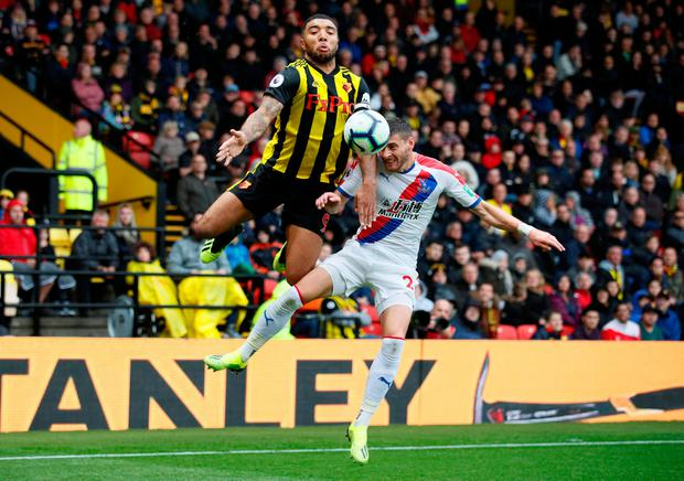 Watford's Troy Deeney in action with Crystal Palace's Joel Ward. Photo: Reuters/David Klein