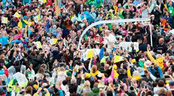 Pope Francis makes his way through crowds in the Phoenix Park. Photo: Maxwells