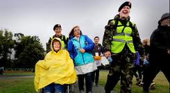 Pte Shauna Bennett and Pte Caoimhe Molly help Kathleen Ryan and Elizabeth Spencer from Dublin as they arrive in the Phoenix Park for Pope Francis's closing Mass. Photo: David Conachy